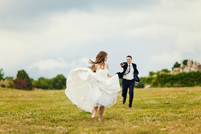 bride-and-groom-running-away