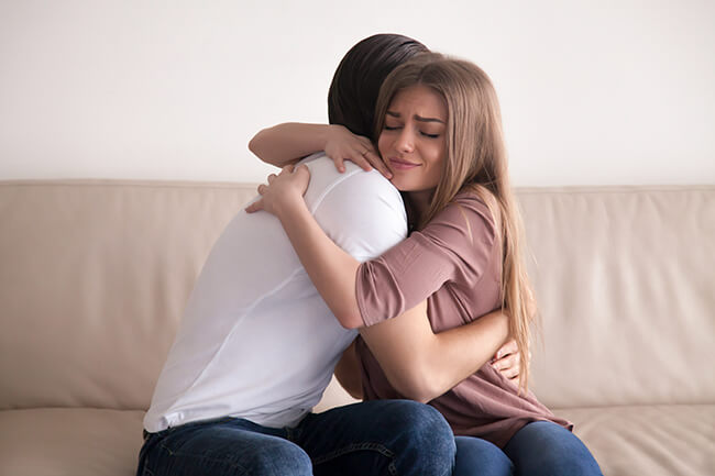 caucasian-couple-hugging-and-smiling