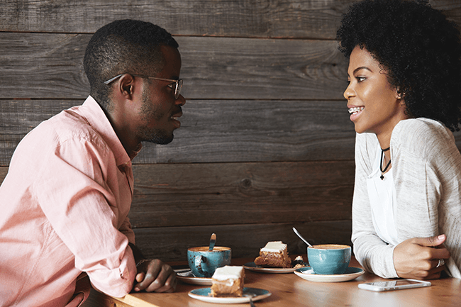 happy-african-american-couple-having-a-conversation-over-coffee