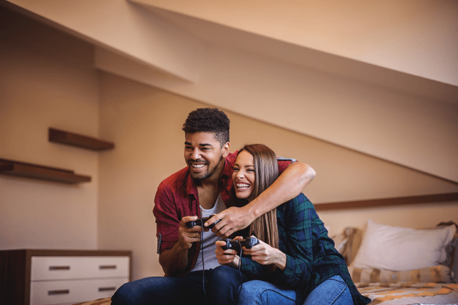 happy-couple-playing-video-games-inside