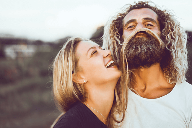 man-with-curly-hair-laughing-with-wife