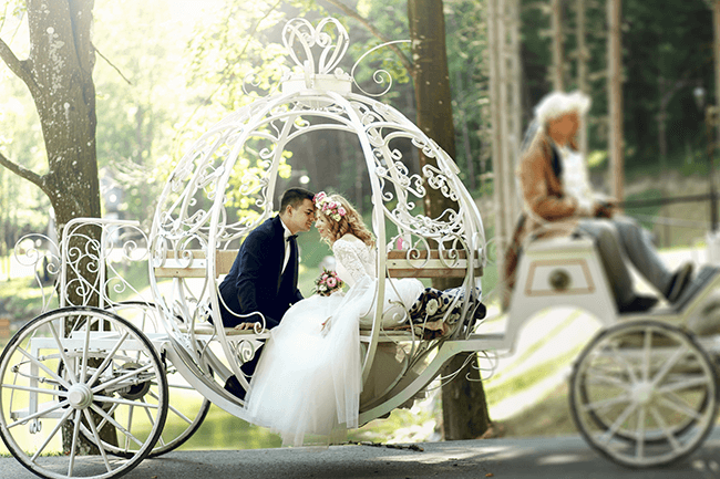 married-couple-in-a-fairytale-carriage