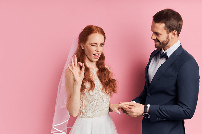 red-headed-bride-smirking-with-husband