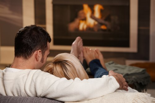 couple_cuddle_in_front_of_fire