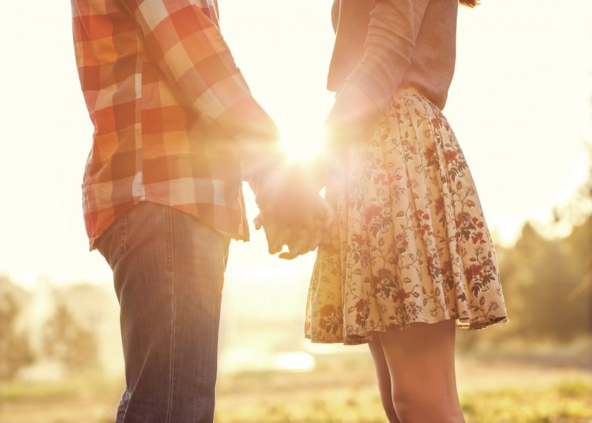 couple-holding-hands-sunset