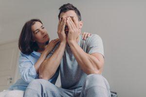 woman-comforting-depressed-partner