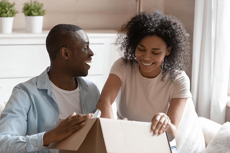 black-couple-smiling unpacking