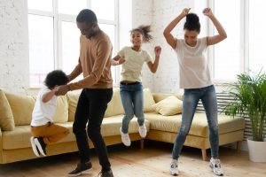 family having a dance party in the living room