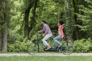 couple-on-a-tandem-bicycle