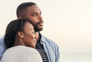 african-american-couple-looking-at-the-ocean