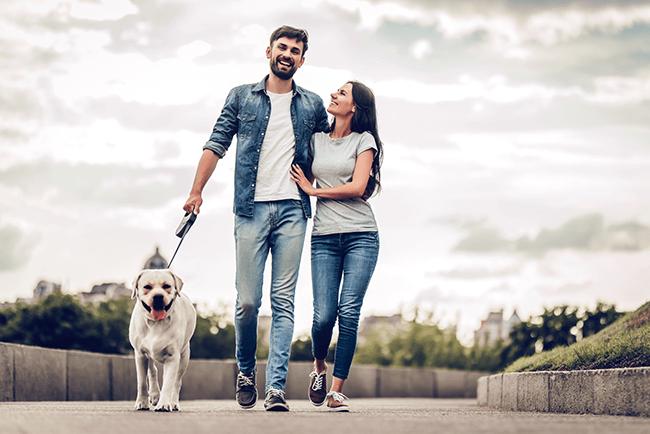 smiling-happy-walking-dog-outside