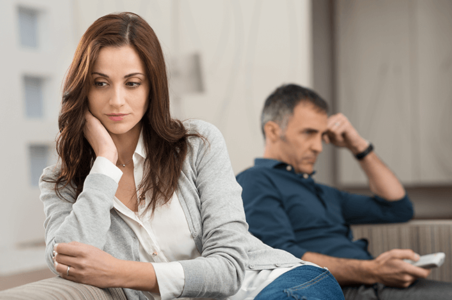 unhappy-couple-sitting-on-the-couch