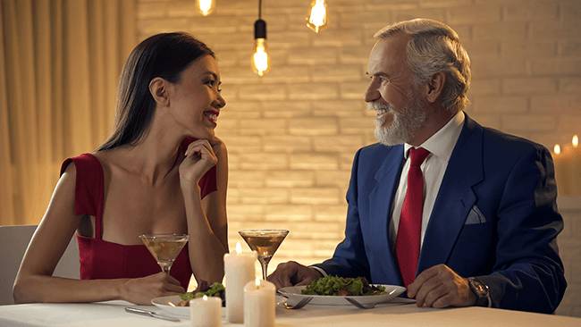 young-darkhaired-girl-dining-with-older-man